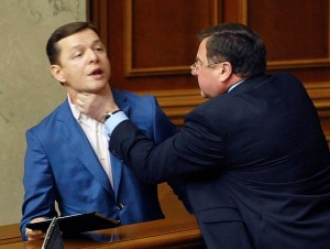 Vice speaker of the Ukrainian Vekhovnaya Rada Martynyuk scuffles with deputy Lyashko during a session in the chamber of the Ukrainian parliament in Kiev