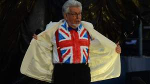Australian artist Rolf Harris shows off