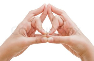 A man's hands is shown in yoga mudra