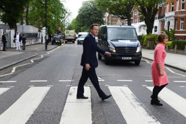 Britain's Prime Minister David Cameron walks accross the pedestrian crossing outside Abbey Road studios with former minister Tessa Jowell (R) in London, Britain, May 20, 2016. REUTERS/ Jeremy Selwyn/Pool